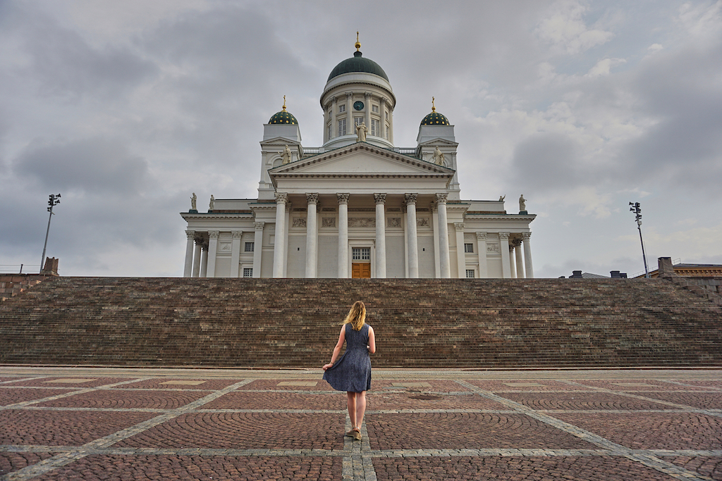 Girl standing in front of a chiurch